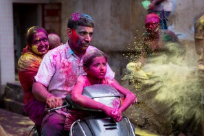 A family trying to make its way during the festival of Holi. Jodhpur, India.