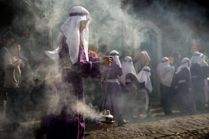 Spreading incense in font of the procession
